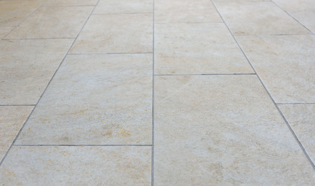 Dirty Outside Terrace Tiles. Image of exterior flooring with grey beige pavement slabs.