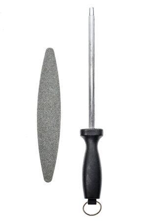 honing: Grindstone or whetstone and sharpener on white background. Kitchen utensils