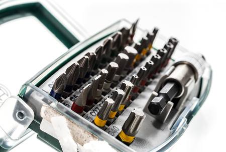 Different Security screwdriver drill heads and accessories in a box.