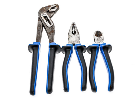 color photo: Set of old, used pliers isolated in studio. Color photo od different blue pliers set.