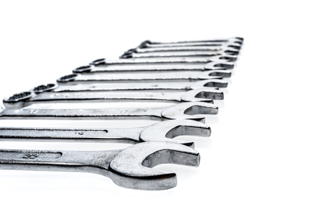 metric: Set of wrenches isolated on white background. Metric set of work tools in a black tool box. Stock Photo