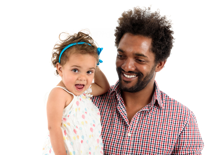 African American father and mulatto daughter together isolated on white background. Happy single parent. Man is wearing afro hair style and a color shirt. Stock Photo - 60390290