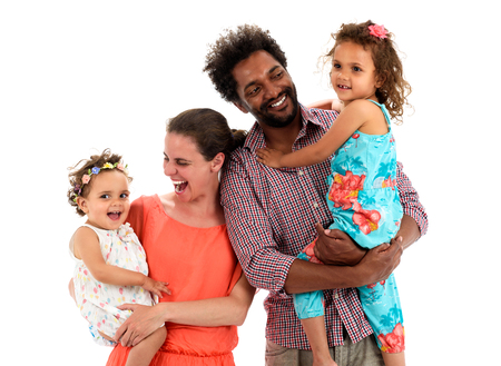 Happy interracial family is celebrating, laughing and having fun with Hispanic African American Father, Caucasian mother and Mulatto children daughters.  Isolated on white. Stock Photo - 60390294