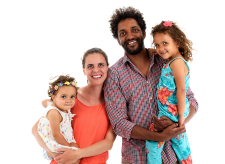 interracial family: Happy interracial family is celebrating, laughing and having fun with Hispanic African American Father, Caucasian mother and Mulatto children daughters.  Isolated on white.