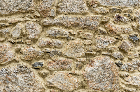 road paving: Natural yellow pavement stone texture for floor, wall or path. Traditional fence, court, backyard or road paving.