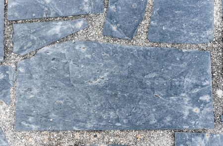 road paving: Natural paving stone slabs flor, walkway or sidewalk texture. Traditional fence, court, backyard or road paving.