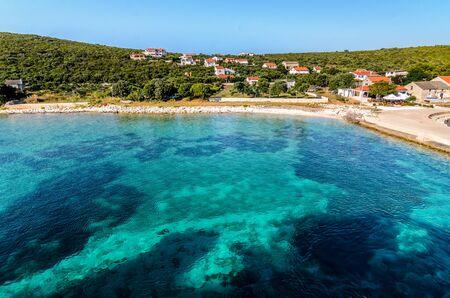 A blue green paradise lagoon in Croatia. Turquoise sea in idyllic bay in Croatian island Premuda.