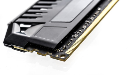 Modern Professional RAM memory module with black radiator heat sink isolated on white background