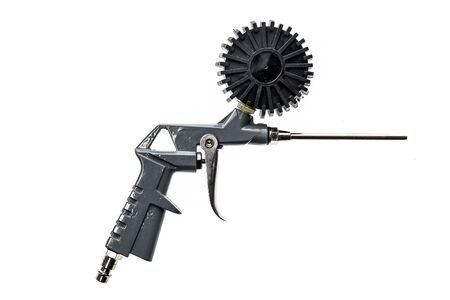 Air compressor gun with manometer isolated on a white background. Close up of blow gun for compressed air as a part of air compressor system with manometer pressure gauge and other accessories. Stock Photo