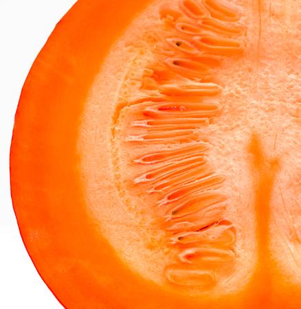 insides: The insides of Red kuri squash - Orange Hokkaido pumpkin isolated on white. Uchiki Kuri Squash, Japanese Squash or Baby Red Hubbard Squash photographed in tabletop studio.