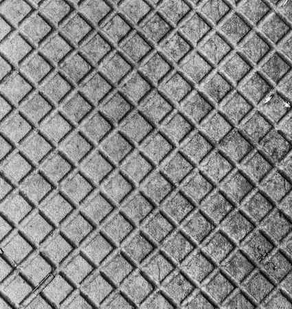 sewer: Old rusty metal street sewer drain cover top hatch texture. Close up of steel cover made of squares. Dimension 1x1 cm. Stock Photo