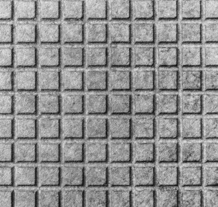 sewerage: Old rusty metal street sewer drain cover top hatch texture. Close up of steel cover made of squares. Dimension 1x1 cm. Stock Photo
