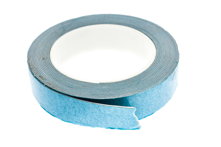 sided: Double sided Foam Adhesive mounting tape isolated on white background. A roll of industrial construction bonding sticky tape for furniture or mirror mounting.