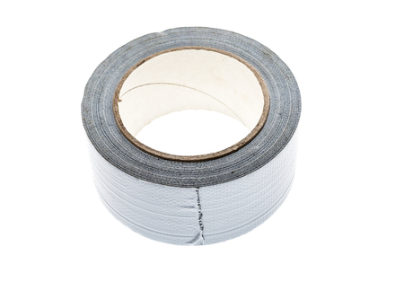 sellotape: Silver duct gaffer repair tape roll isolated on white. Close up of sticky reel of adhesive repair tape on white background. Stock Photo