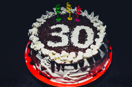 Home Made Birthday Cake For 30th With Three Candles Stock Photo