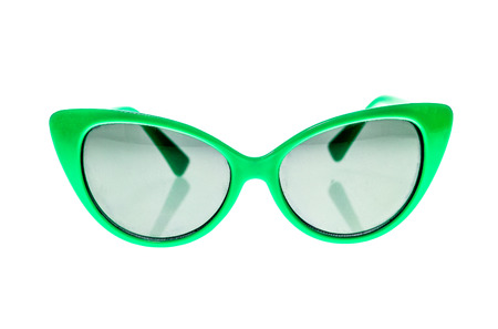 children's wear: Green Children sunglasses, sun shades or spectacles isolated on white background. Color child glasses protection from sun and UV rays. Concept of sun protection and vacation.