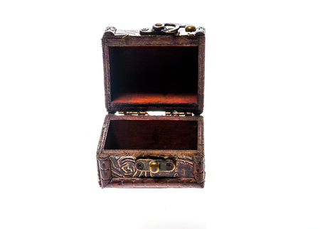 jewlery: Old wood chest jewelry box closed isolated on white background. Small miniature vintage treasure chest for keeping jewelry such as necklace, rings or earrings.