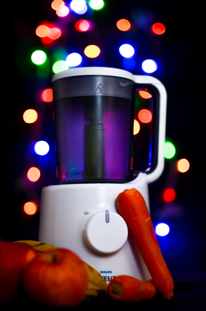 Ljubljana, Slovenia - March 5, 2013: Philips Avent Combined Steamer And Blender isolated on black background with color bokeh lights in the background, Editorial