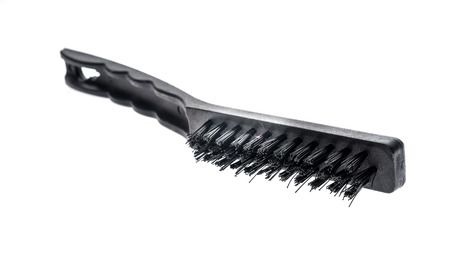 work took: Black industrial metal wire brush scraper isolated on white background. Industrial work took for scraping. Stock Photo