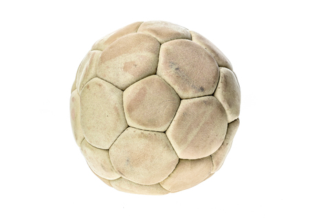 Old, used and washed handball ball isolated on white. Old, used and obsolete sports equipment. Stock Photo