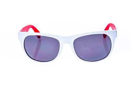 Color Children sunglasses, sun shades or spectacles isolated on white background. Color child or adoult men or woman glasses protection from sun and UV rays. Concept of sun protection and vacation. Stock Photo
