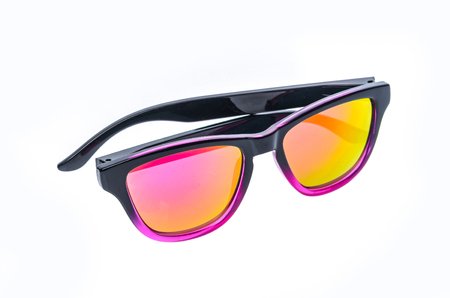 children's wear: Fashion Children sunglasses, sun shades or spectacles isolated on white background. Color child glasses protection from sun and UV rays. Concept of sun protection and vacation.