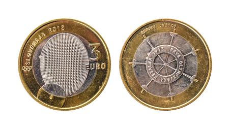 Used commemorative anniversary bimetal 3 euro € Slovenia coin 2012. Worn out special three euro coin from Slovenia. Stock Photo