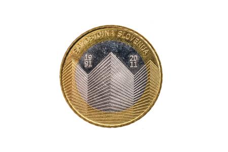 Used commemorative anniversary bimetal 3 euro Slovenia coin 2011. Worn out special three euro coin from Slovenia. Stock Photo