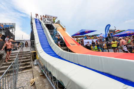 slide show: Velenje, Slovenia - June 24, 2017: Pljusk na Velenjski plazi extreme sports lake jumping competition event. Different extreme activities including slip and slide, bike, skate and roller ramp jumping in the lake.