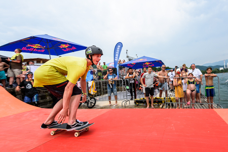 rollerblades: Velenje, Slovenia - June 24, 2017: Pljusk na Velenjski plazi extreme sports lake jumping competition event. Different extreme activities including slip and slide, bike, skate and roller ramp jumping in the lake.