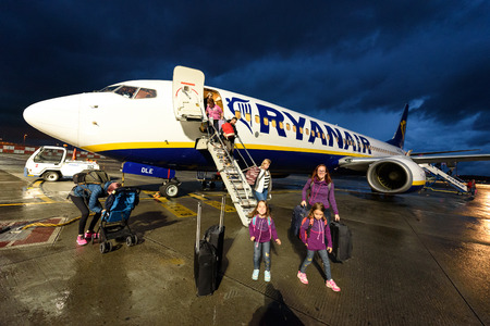 SANTIAGO DE COMPOSTELA, SPAIN - MAY 10, 2017: Passengers disembarking Ryanair flight from Milano Italy to Santiago Spain at night. Ryanair is biggest budget low-cost airline in the world.