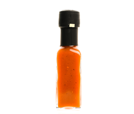 Hot Chili Sauce glass bottle on white background. Different color home made hot sauce in glass bottle.  100ml square bottle. Isolated on white background.