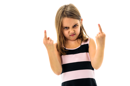 Little young girl is angry, mad, disobedient with bad behaviour.