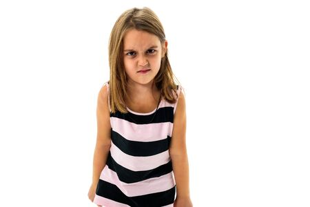 Little young girl is angry, mad, disobedient with bad behaviour. Children making the act of insubordination and disobedience, yelling, showing teeth, behaving crazy.