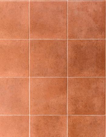 Interior or exterior bathroom or kitchen square ceramic tiles. Image of interior flooring with red orange pavement slabs. Dimension 30 x 30 cm