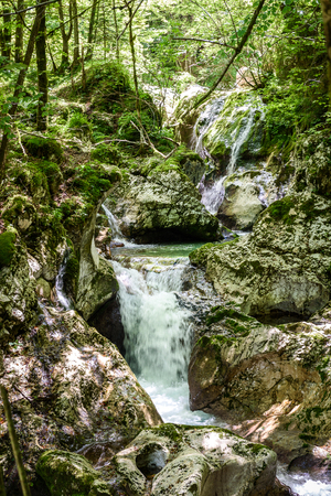 Idyllic mountain river in Lepena valley, Soca - Bovec Slovenia. Sunik water grove - beautiful mountain stream with waterfall and pools of green turquoise water.