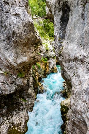 Velika Korita or Great canyon of Soca river, Bovec, Slovenia. Beautiful vivid turquoise river stream rapids, running through canyon surrounded by forest. Soca river, Triglav National Park, Julian Alps, Slovenia, Europe. Stock Photo