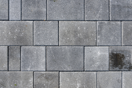 Concrete or cobble gray pavement slabs or stones  for floor, wall or path. Traditional fence, court, backyard or road paving.