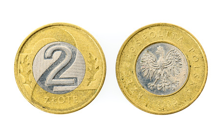 Old used two Polish Zloty coin isolated on white background. Heads and tails - both sides of polish currency money zloty. Stock Photo
