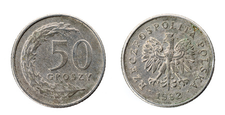 Old used fifty Polish groszy coin isolated on white background. Heads and tails - both sides of polish currency money groszy - zloty. Stock Photo
