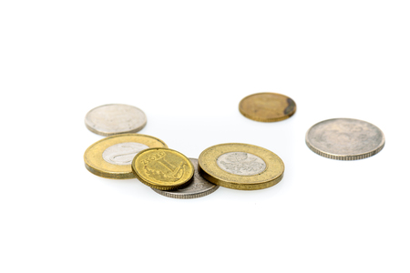 Different Polish Zloty and grosz coins isolated on white background. Polish zloty coins, money, currency of Poland laying randomly on white background. Stock Photo