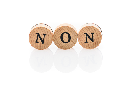 Word Non from circular wooden tiles with letters children toy. Concept of