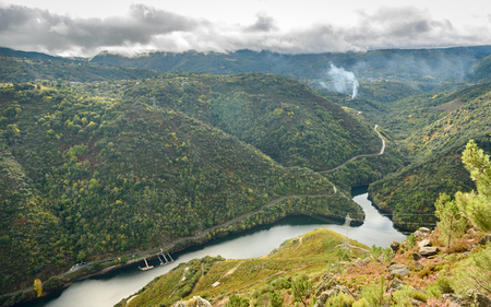 Lookout view of canyon, valley and vineyards along river Sil. Viewpoint Mirador do Duque above Sil river,River Sil Canyon, Galicia, Spain. Home of famous spanish vine.