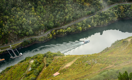 Lookout view of canyon, valley and vineyards and boats along river Sil. Viewpoint Mirador do Duque above Sil river,River Sil Canyon, Galicia, Spain. Home of famous spanish vine.