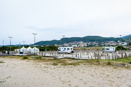 Parking spot for motorhomes or campervans in Afife beach Portugal. Empty recreation spot for recreation vehicles or RVs on the sandy beach on the Atlantic coast in Portugal. Stock Photo - 120195101
