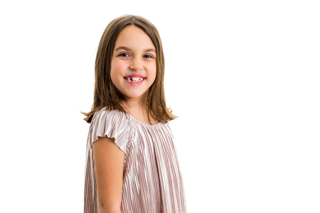 Portrait of happy young little girl with emotions on white. Portrait of a cheerful cute little child girl looking at the camera and smiling. Happy children. Isolated on white background.