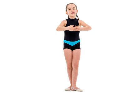 Girl child practice and doing rhythmic gymnastics portrait, white background. Young girl is dancing and having fun performing rhythmic gymnastics exercises. Isolated on white background.