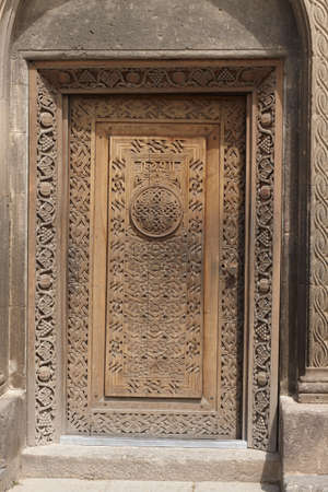 large doors: the door of the church of st. Hovhannes, Sisyan, Armenia, church about XII century, the door about XIX century