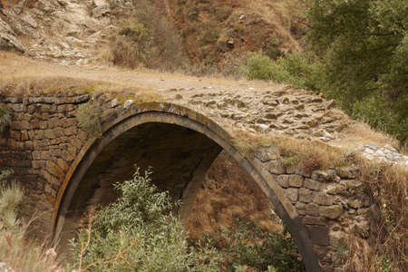 brige: the old brige in Darabas vilige, near Sisyan town, Armenia, about X century, over one of branches of river Vorotan  Stock Photo