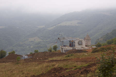 constraction: unfinished constraction of cableway station near Tatev monasteri, Armenia, (it must finish ar 16 of october and must be the most big cableway in the world) Stock Photo